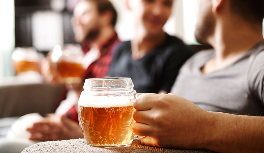 friends watching football with beer