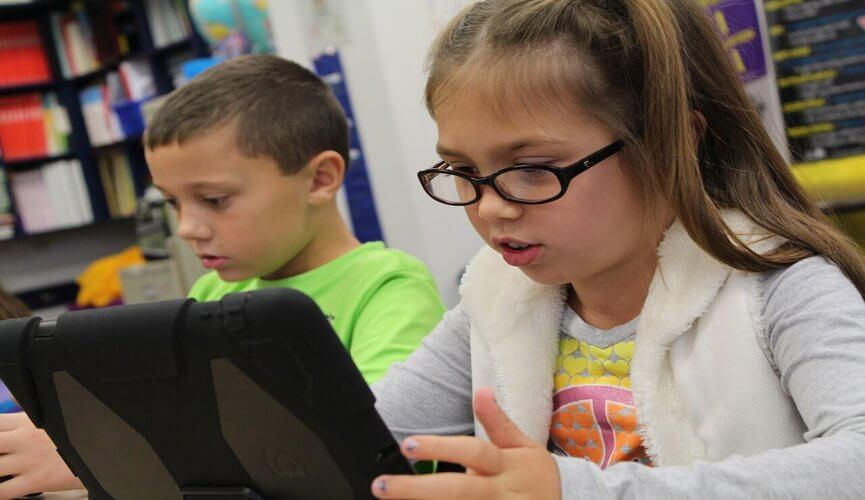 children using tablets at school